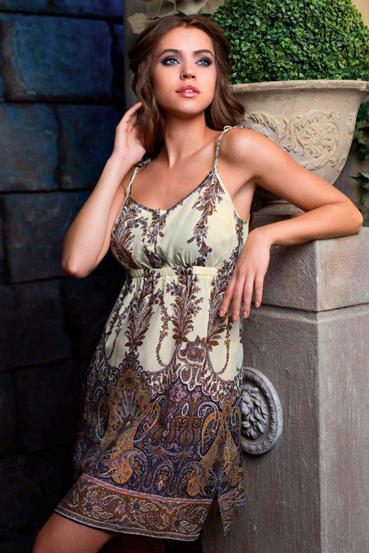 Сорочка средней длины (до колен) прямого силуэта выполнена из вискозы с фантазийным принтом фото