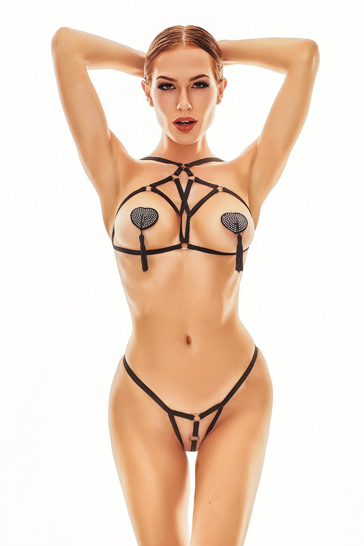Черный эротический комплект нижнего белья выполнен из эластичных ремешков-резиночек фото